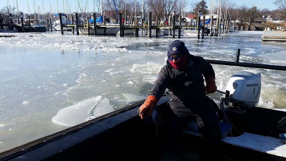 Herrington Harbour North marina employees break up to 5 inches of ice in Tracy's Creek