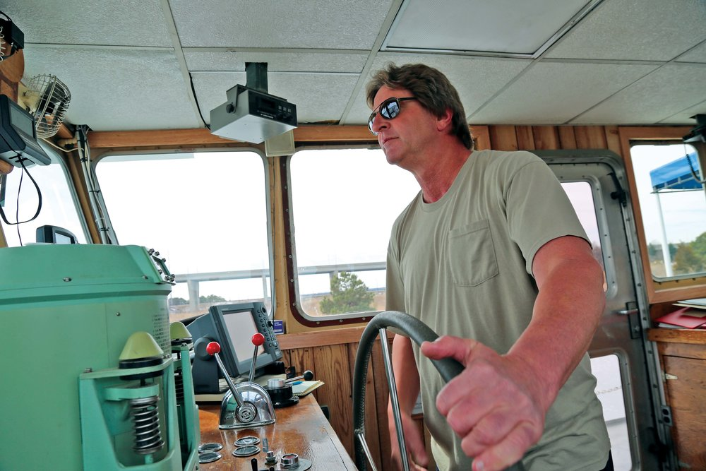 Shawn Orr takes the helm.  Photo by Wendy Mitman Clarke