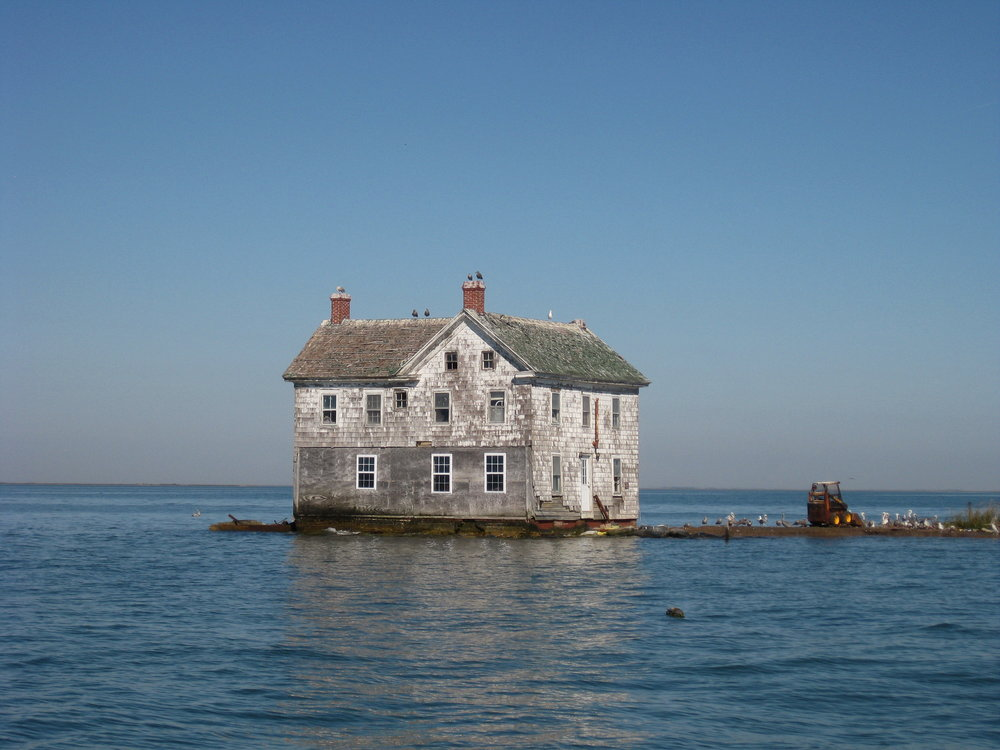 Holland Island's last remaining house, before it fell into the Bay in 2010