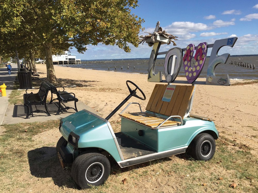 "Colonial Beach's ""LOVEwork"" display—a tribute to Colonial Beach's golf-cart town tradition, local beach vibe, and a tourist attraction, all in one.  photos by Jody Argo Schroat"