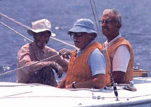 Sandy Douglass  (left) retired from racing as he grew older, but he never stopped sailing—usually going out in boats of his own design.