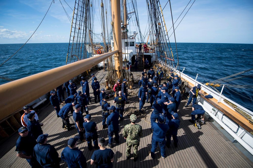 USCG officer candidates prepare to climb Eagle's mast. Photo: U.S. Coast Guard/Petty Officer 2nd Class Richard Brahm