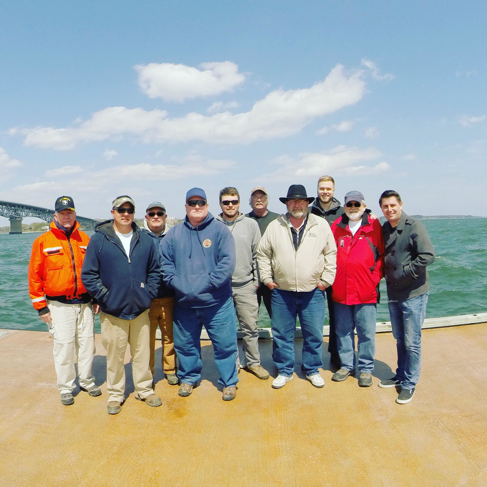 The York River scan crew, from left to right: Bill Utley (ASV Maritime Heritage Chapter), Jason Rayfield (Boat Captain, Precon Marine), David Thompson (Portunes International), Brian Abbott (Abbott Underwater Acoustics), Derek Miller (Boat Captain, Precon Marine, Mid-Atlantic Marine Corp.), Bill Waldrop (Standby Diver, ASV Maritime Heritage Chapter), Steve Ormsby (President, JRS Explorations), Tyler Neese, John Broadwater (Underwater Archaeologist, Vice President, JRS Explorations), Ryan Johnston (CEO, JRS Explorations).