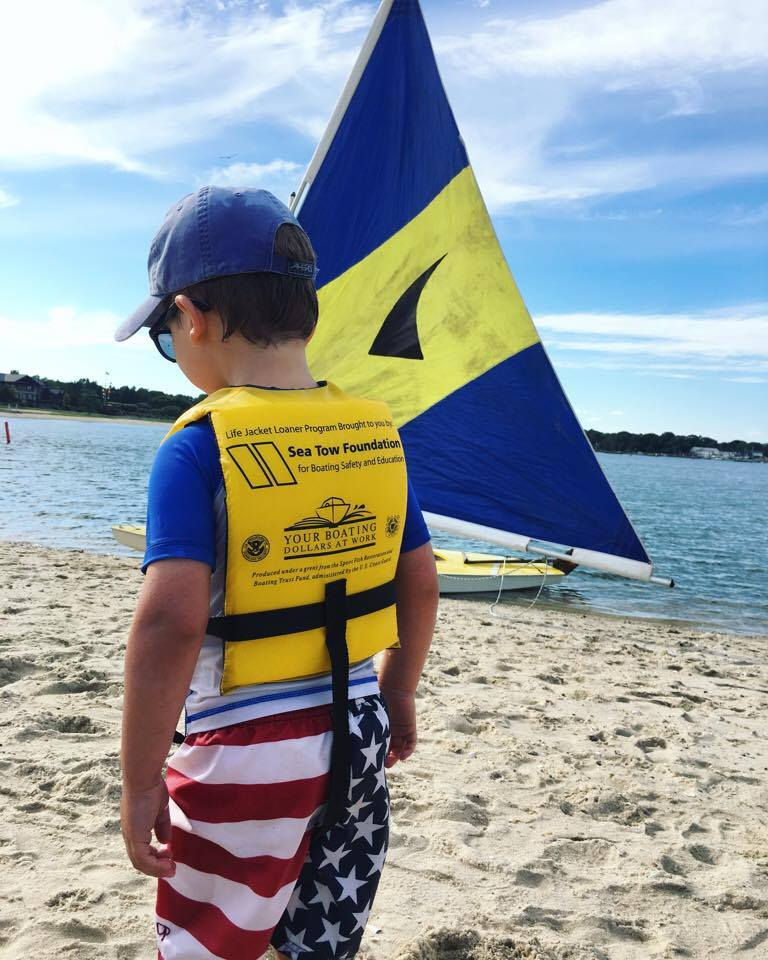 A young boater ready to go in a Sea Tow Foundation life jacket. Photo: Sea Tow Foundation