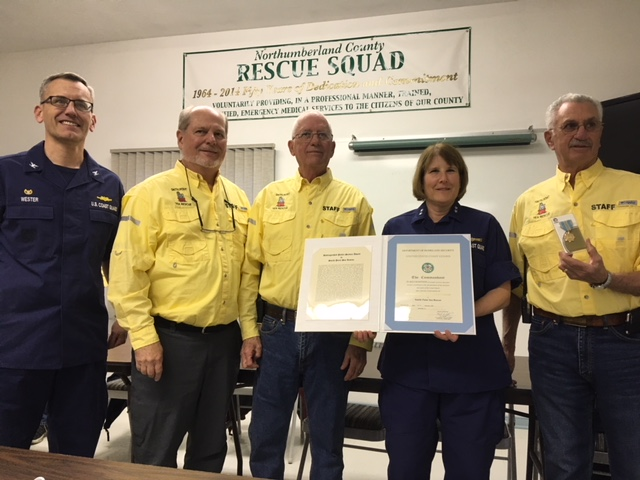 USCG Rear Admiral Meredith Austin presents the Distinguished Public Service award to Smith Point Sea Rescue. Pictured left to right: USCG Captain Rick Webster, SPSR Vice President Jim Bullard, SPSR Senior Boat Captain Buddy Sylvia, USCG Rear Admiral Meredith Austin, SPSR President Andy Kauders, and USCG Senior Chief Brian Martin.