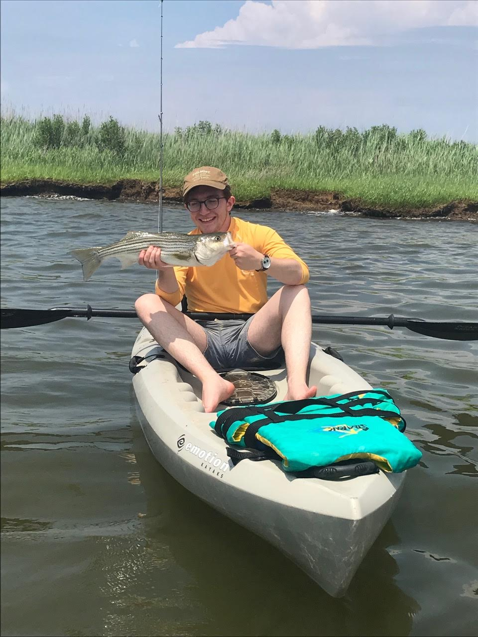 Exchange student Pablo Ortuño of Spain landed his first striper casting topwater plugs with fly trailers. He and Nathan Lampshire were fishing south of Kent Narrows. (Photo: Nathan Lampshire)