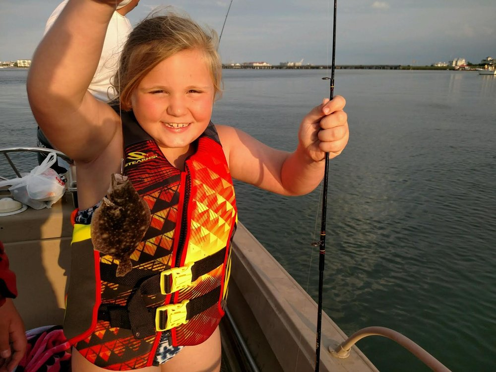 Julie Bright of Salisbury landed this undersized summer flounder the other day drifting shiners over the shoals behind Ocean City. Maybe next drift Julie! (Photo Courtesy of Karl J. Bright)
