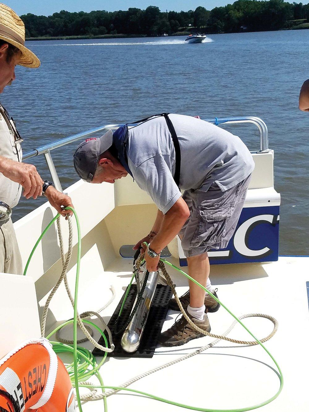 Dr. Douglas Levin deploys the sonar.Photos by Nancy Taylor Robson