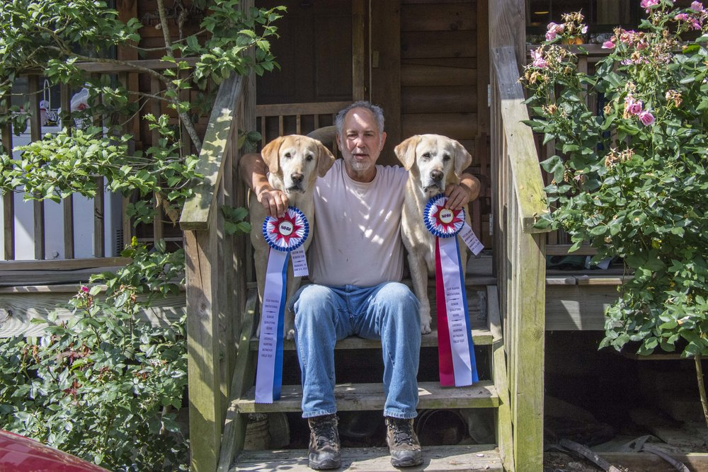 Larry Housman with champion labs Bry and Hank. Photo: Mike Tome/Duckdog Photography