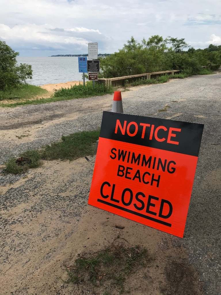 swimming beach closed sign aaco.jpg