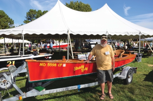 Karl Nisson shows off his home-built crab skiff outfitted with a customized wicker porch chair and a 20-hp, 625cc industrial compressor engine. Photo by Dick Cooper.