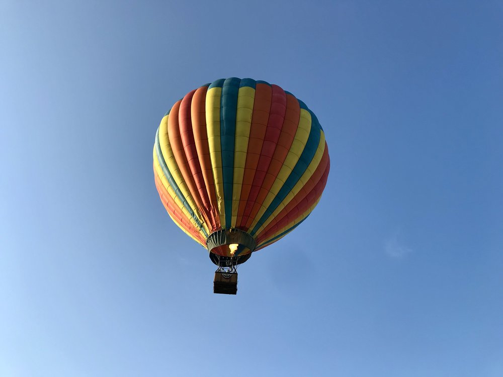 """As this balloon takes flight, its burner ignites, mixing propane and air to power the balloon by directing the flame and exhaust created up into the """"envelope"""" of the balloon, or the area at the base of the balloon, just above the basket."""