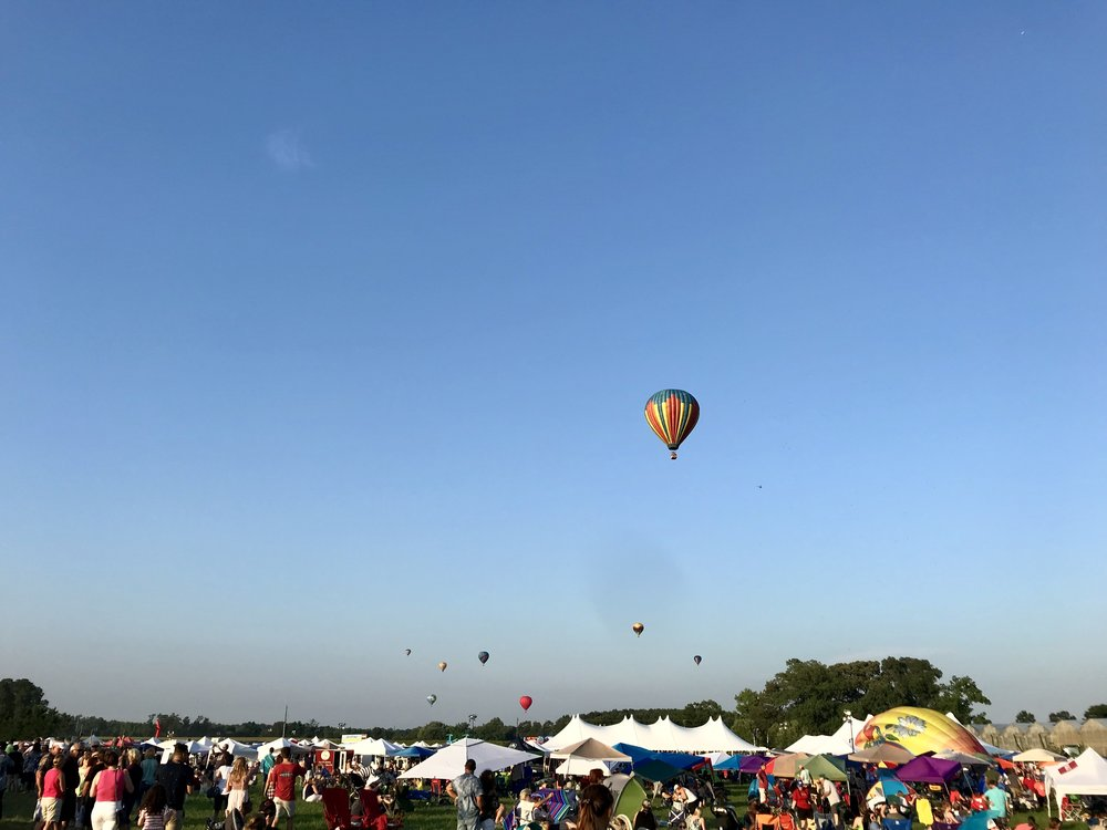 Festivalgoers turned their eyes to the sky to watch the balloons ascending overhead, drifting to landings in the fields of Talbot County, Maryland.