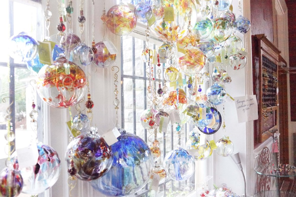Glass baubles decorate the window of My Jewelry Place.  photo   by: Chris Landers