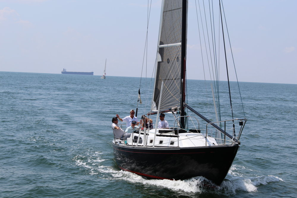 The  Black Widow  sails across the Chesapeake Bay Saturday during the 15th annual Leo Wardrup Memorial Cape Charles Cup. Wardrup was one of the founding members of the regatta and an owner of the  Black Widow . Photo: Clara Vaughn