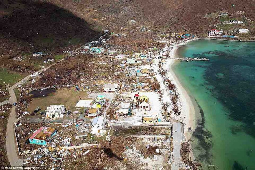 In this photo of the Jost Van Dyke beachfront just after Irma, Foxy's Tamarind Bar is at the far end, covered with blue tarps.