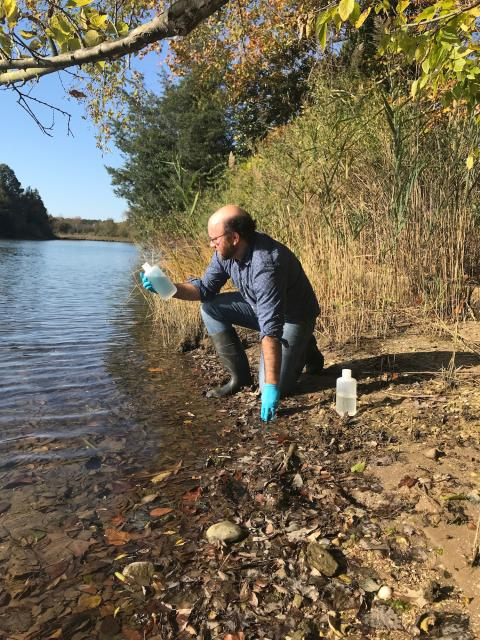 Study author Louis Plough takes a water sample. Photo: UMCES