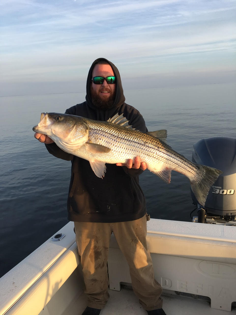 Fishing with Nick Fulford on Nick's boat  Defiance , Chris Lankford, Seaford DE, jigged up this fine rockfish near Hooper's Straits on Sunday. (Photo courtesy of Nick Fulford)