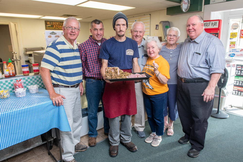 The southern Maryland stuffed ham tradition is supported by folks like, from left, Ray Raley, Matt Bowes, Samuel Pratt, Dan Raley, Carla Tomaszewski, Pat Bowes, and David Dent, pictured here at WJ Dent & Sons country store in Tall Timbers, St. Mary's County.  Photo: Edwin Remsberg Photographs