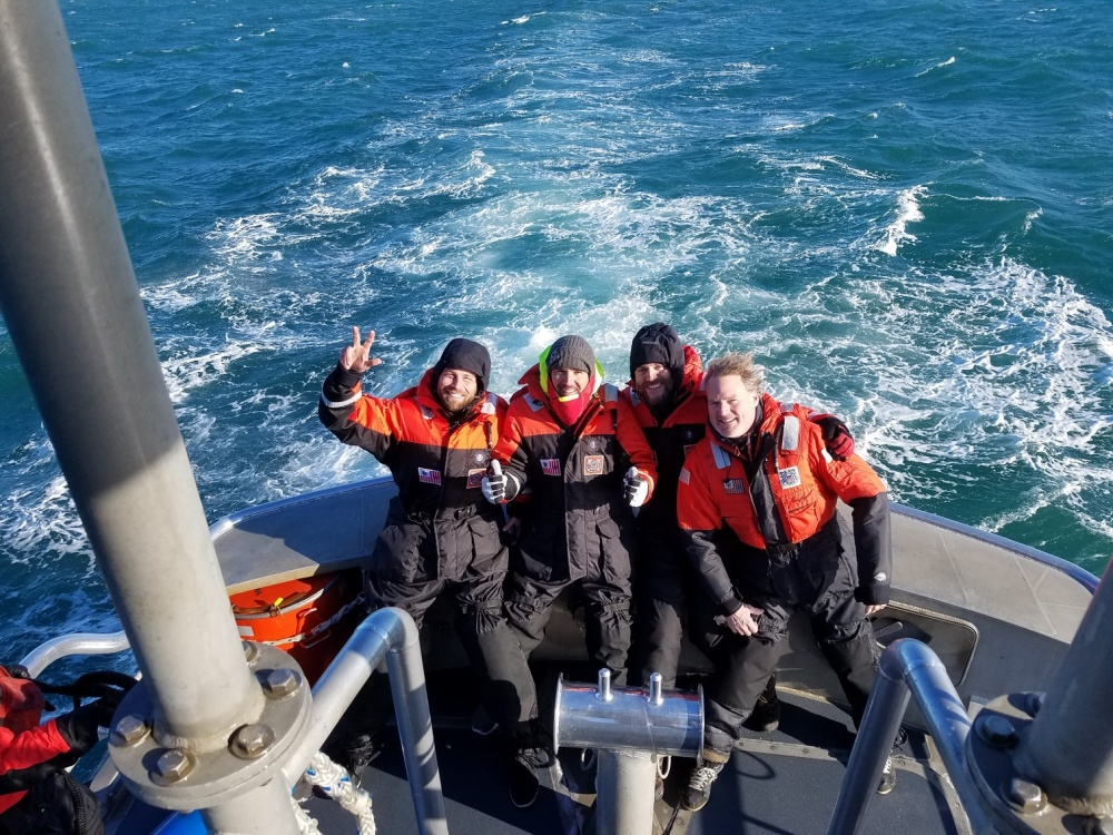 Four mariners are brought back to shore near Morehead City, North Carolina, aboard a 47-foot Coast Guard boat, after being rescued by the crew of the Coast Guard Cutter Escanaba. U.S. Coast Guard photo by Petty Officer 2nd Class Nicholas Healy.
