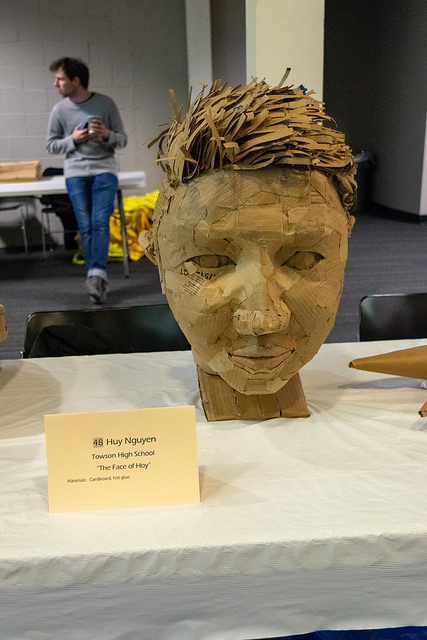 "The Creativity Award went to Huy Nguyen from Towson High School, for ""The Face of Hoy,"" a lifelike portrait using nothing but cardboard and hot glue."