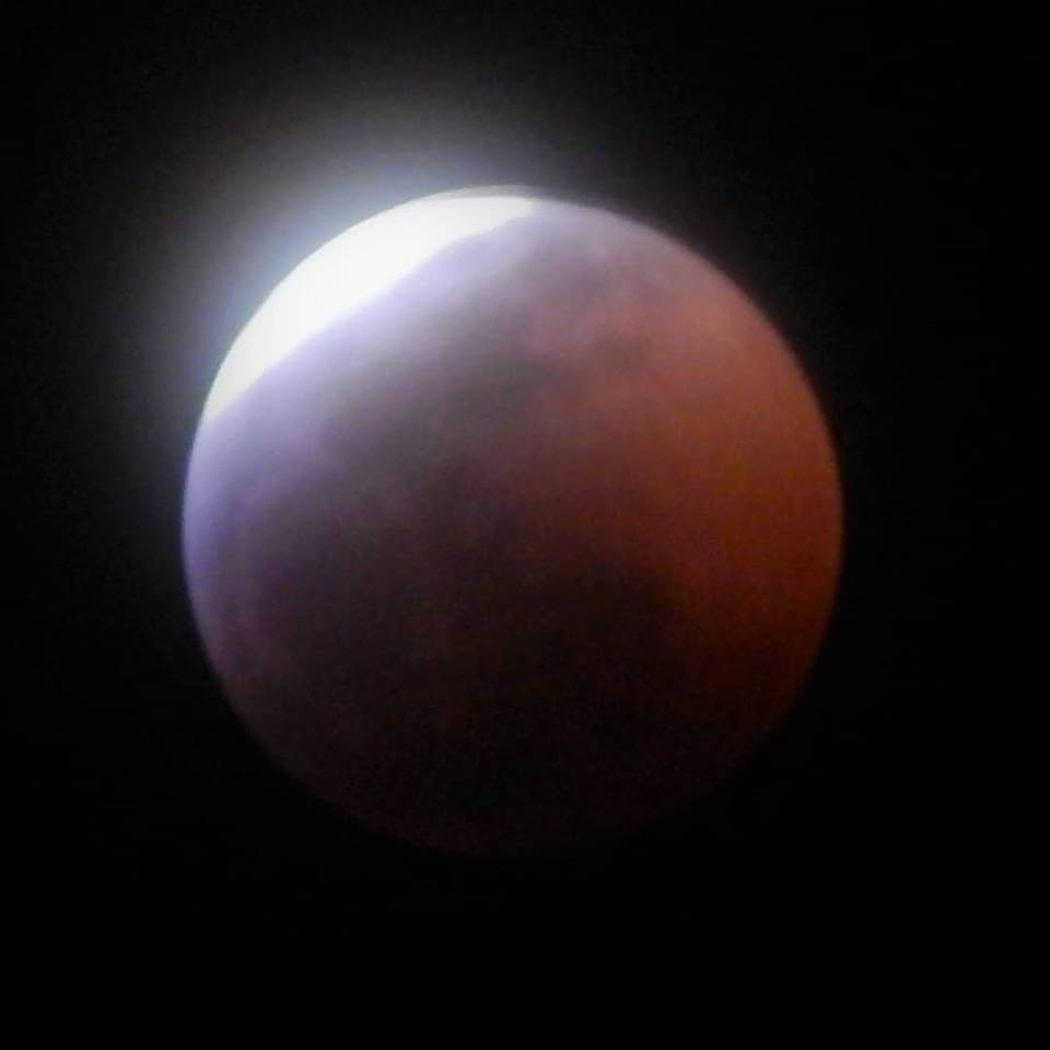 Molly Weeks Crumbley captured this image of the reddish moon in the midst of the eclipse, around 11:35 p.m. Sunday, from Huntingtown, Maryland, near the Patuxent River. Photo: Molly Weeks Crumbley