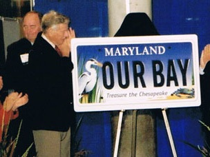 Former Governor Harry Hughes helps to unveil the Treasure the Chesapeake Bay license plate in 2003. Photo: jebdesign.com