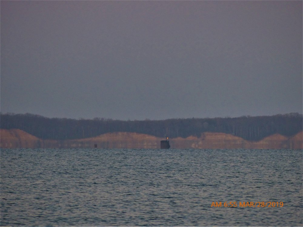 USS  North Dakota  is visible passing Calvert Cliffs at dawn Thursday. Photo: Taylors Island Maryland/ Facebook
