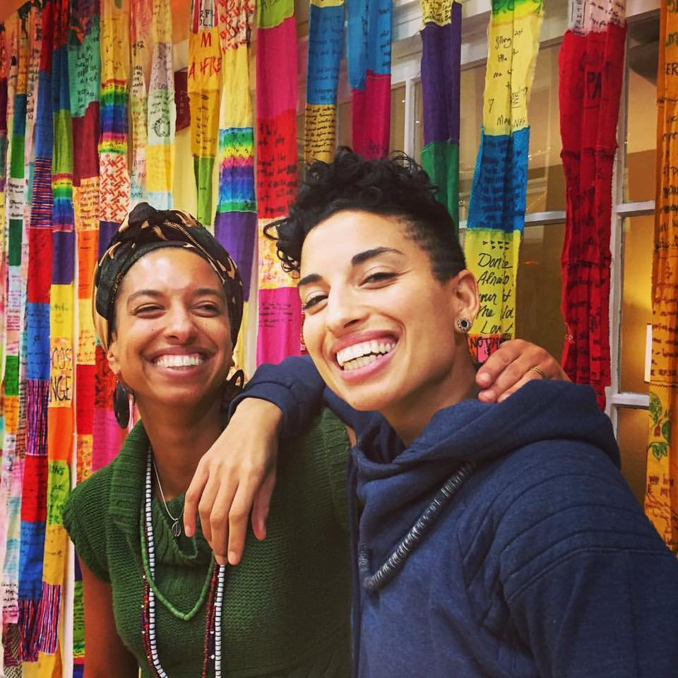 Sisters Leah & Naima Penniman, (w/ S.T.I.T.C.H.E.D. story project installation behind them) - at the Ending Racism: A toolkit for the Spiritual Activists Workshop they led recently at the Deeper Change Forum in New Haven, CT