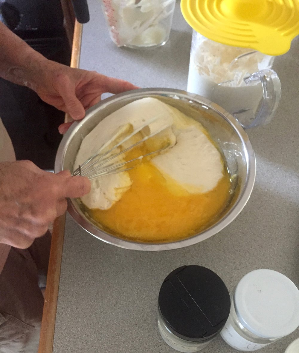 Adding eggs to the batter, just before cooking