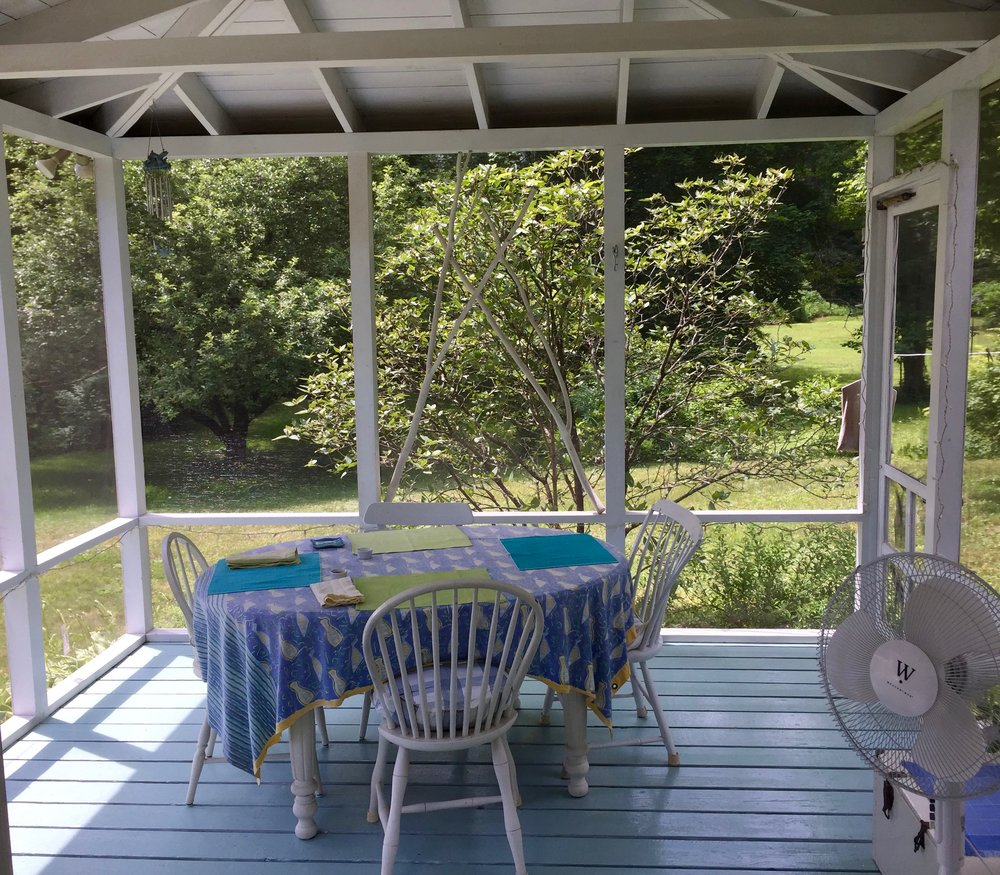 The sun porch where one breakfast is served at the Rock River Cabin