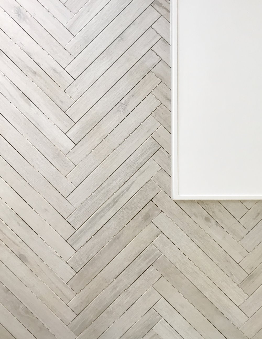Tile featured: Wood of Cerim waterjet to create herringbone