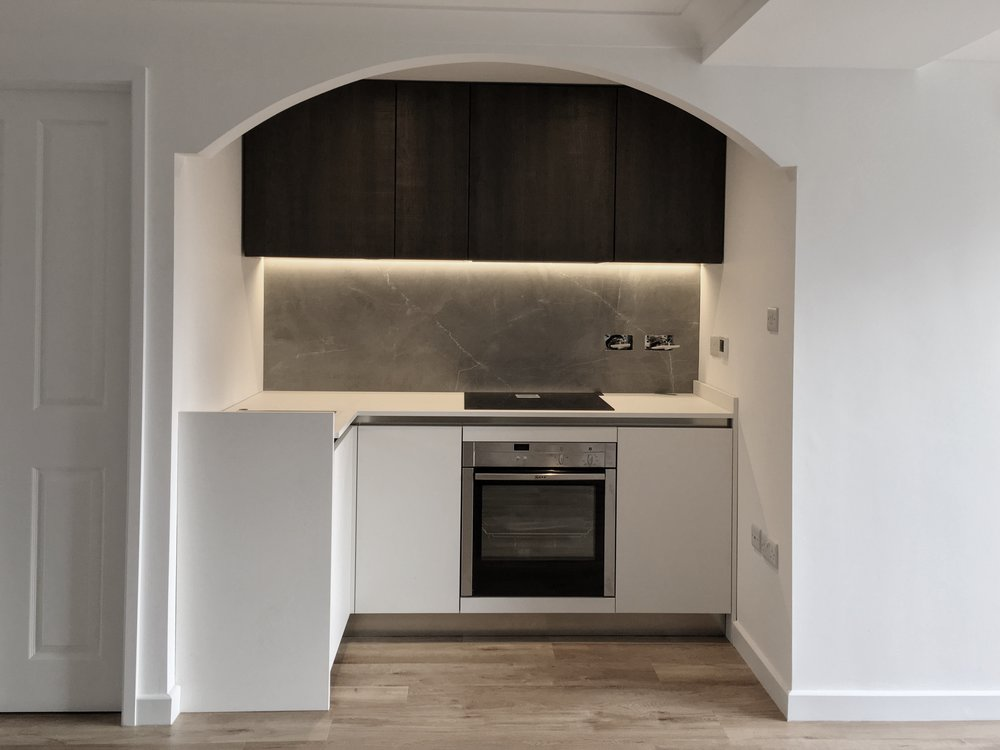 Even a small annex kitchen can benefit from porcelain. The splashback is a single piece of porcelain, templated on site.