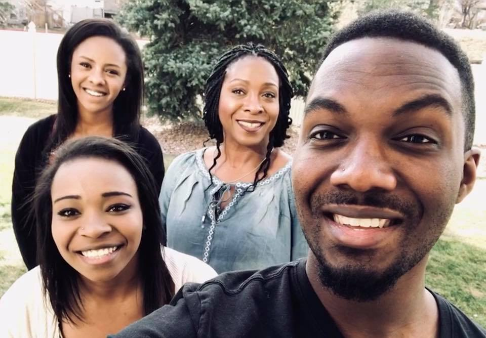 uFoster mom Joy with her adult son and teen daughters