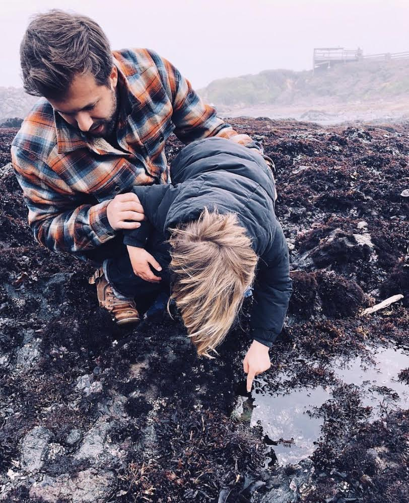 Kyle and our son exploring tidepools in California