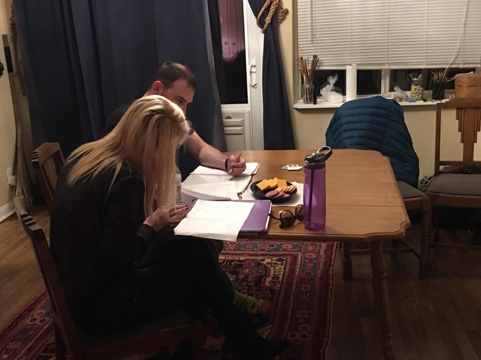 Adam helping A with homework the evening she moved in.