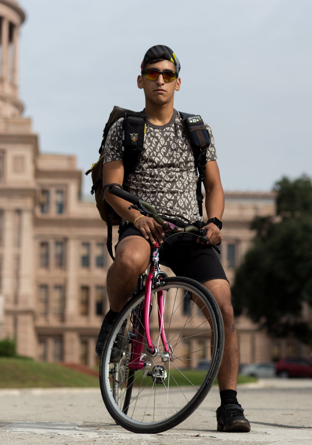 Johnpaul Valenciano has been doing bike courier work around Austin for over three years and currently delivers sensitive documents for local government officials and businesses. Downtown Austin, November 10, 2016.