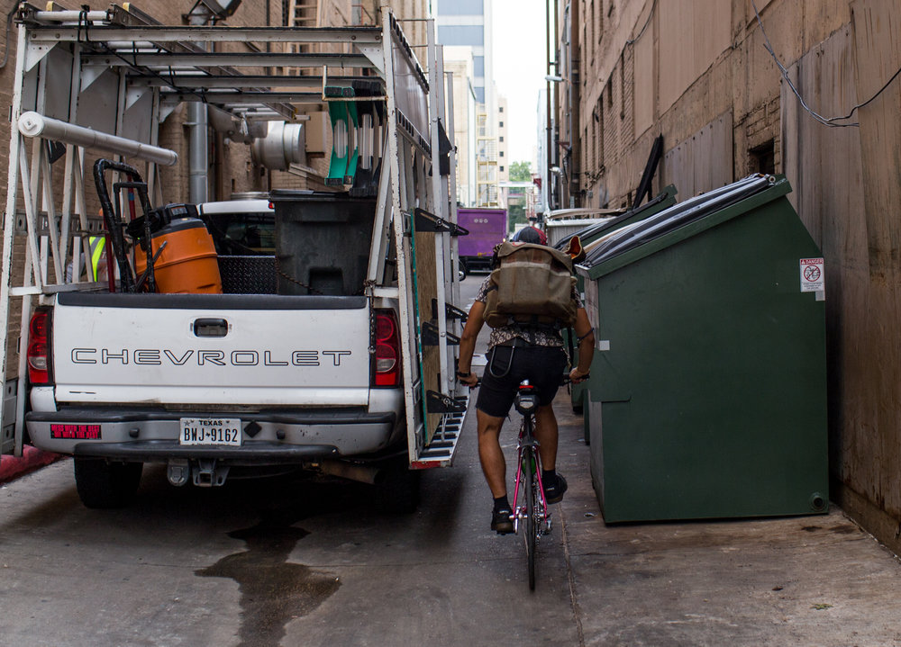 Johnpaul faces daily perils while rushing around downtown. Bike couriers have found it is faster and safer to take routes through downtown's many alleyways. Downtown Austin, November 10, 2016.