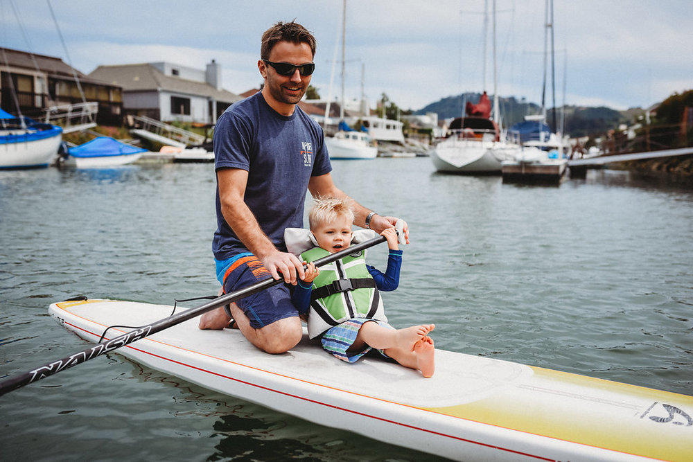SUP paddleboard outdoor activity water nature family time quality time father and son watersports toddler cute fun