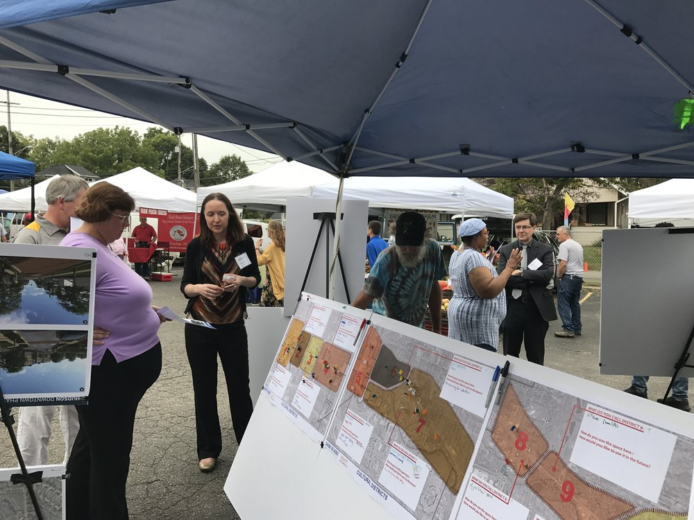 Boards with community input at the farmer's market
