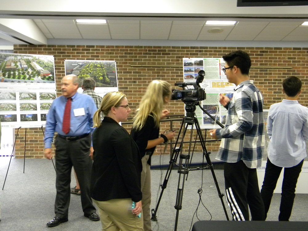 TV reporters cover the workshop