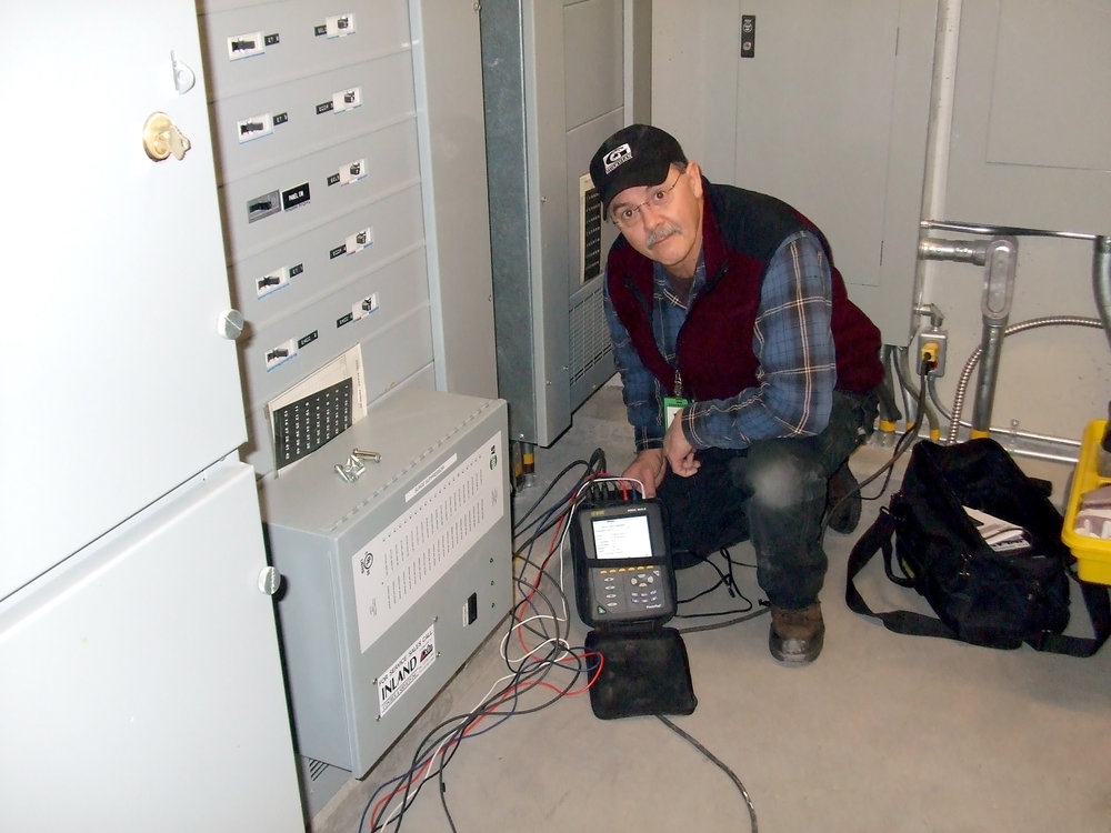Duayne with power analyzer and TVSS.jpg