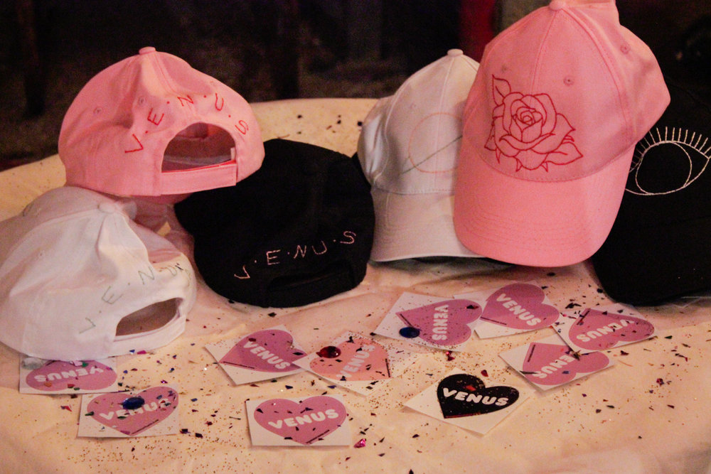 Hats were hand embroidered by our team member, Chloe. Photo by Kassidy Curry.