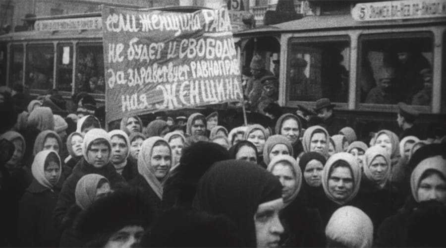 "Russian women protesting in Petrograd in 1917. The banner reads ""If a woman is a slave, there is no freedom."""