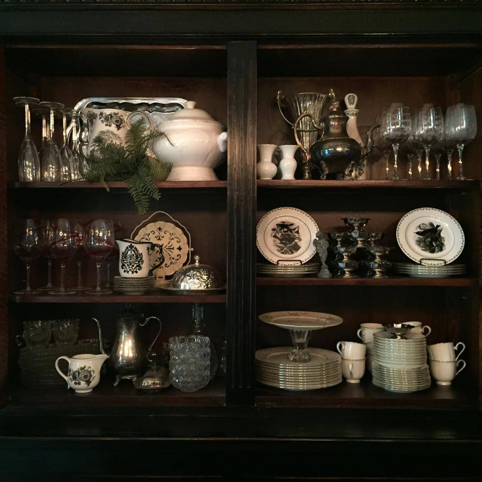 A peek inside the dining room buffet! Don't hide all your pretties...put them on display!