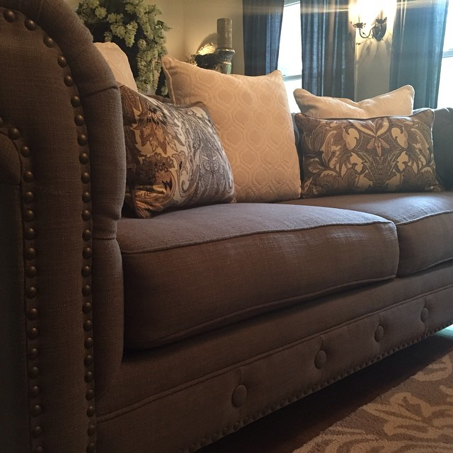 I love the soft contrast of these colors... and who can resist nailhead trim?