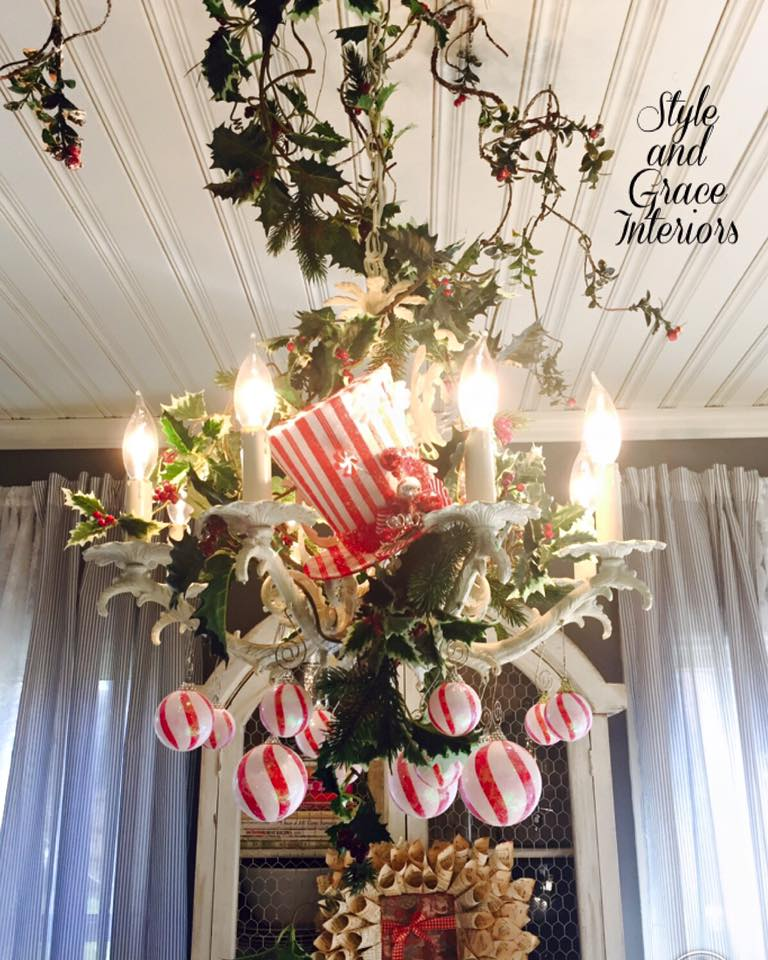 I just love dressing our chandeliers for the holidays! I went for a whimsical look with this beauty in our kitchen! I just love the candy cane inspired ornaments paired with this fabulous little striped top hat!