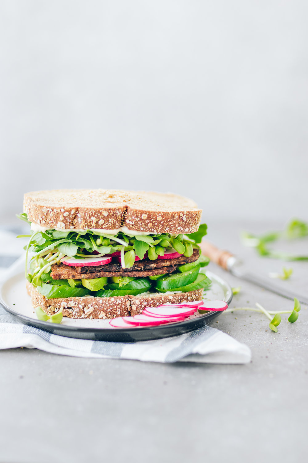 vegan-sandwich-greens-tempeh-bacon-sprouts-spring-simple-mills-radishes-fontaine-sante-hummus