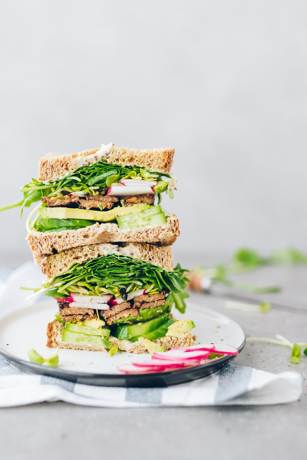vegan-sandwich-greens-tempeh-bacon-sprouts-spring-simple-mills-radishes-fontaine-sante-hummus-stack