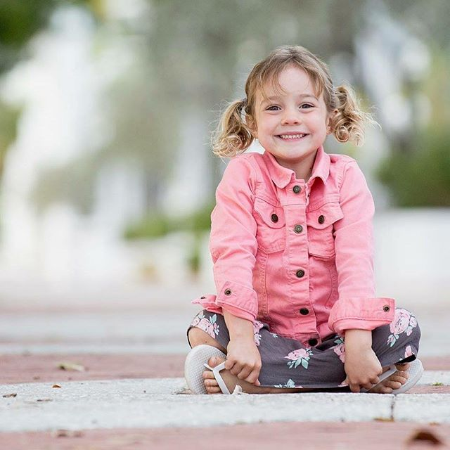 4.5 and rocking her pig tails.  #childphotographer #sarasotaphotographer #siestakeyphotographer #jcphotography